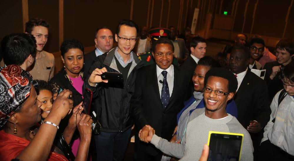 President Jakaya Mrisho Kikwete greets members of the Tanzanian Community based in Seattle  during his one-day visit of the city on Thursday April 2, 2015